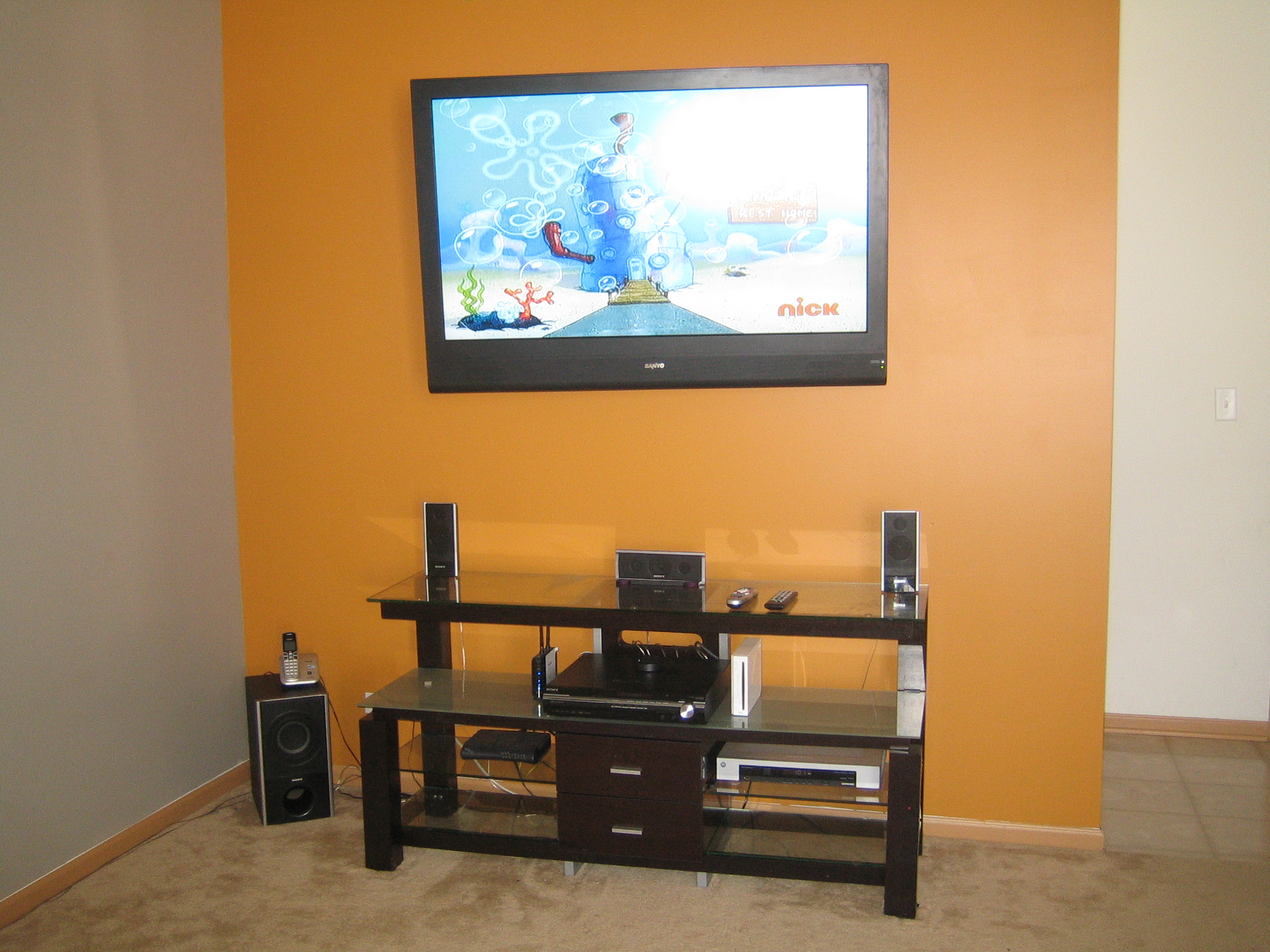 Best Tv Mount Service By Music Evolution Installs Home Installing Theater Wiring Wires Cables Are Ran Through Wall Cavity And An Electric Outlet Is Installed Directly Behind The